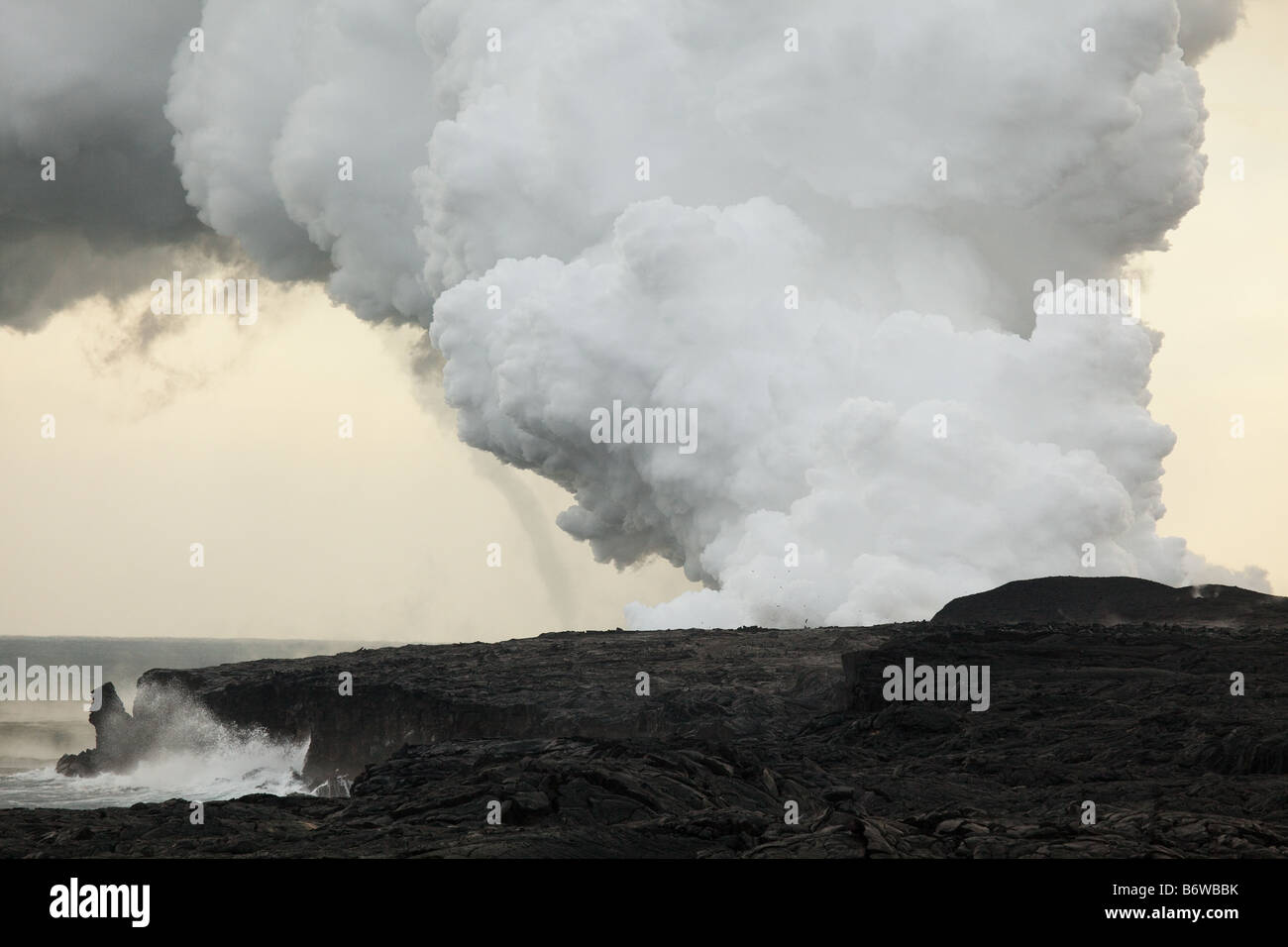 Steam plume and volcanic eruption at Kalapana, Big Island, Hawaii, USA - Stock Image