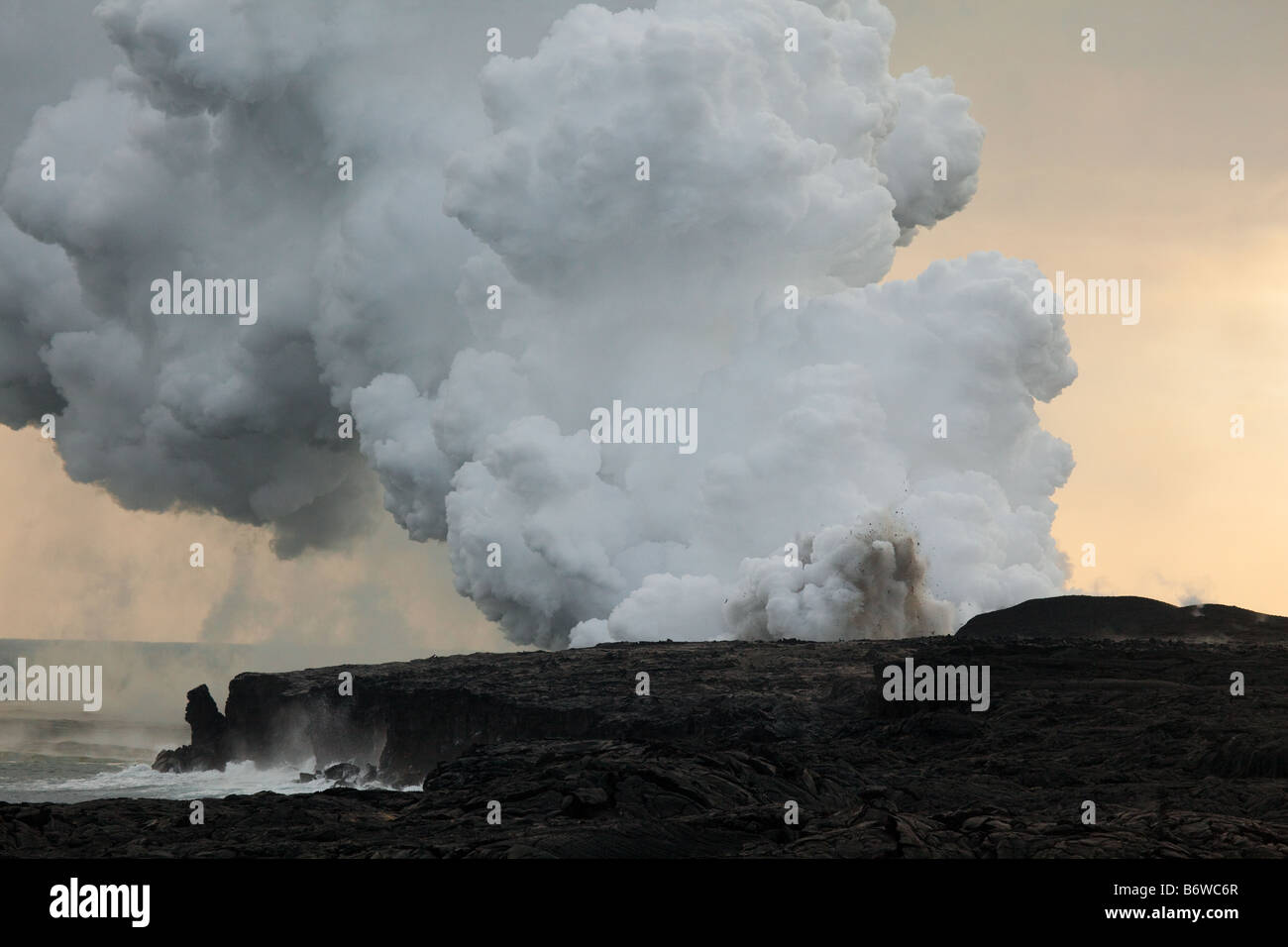 Steam plume and volcanic eruption at Kalapana, Big Island, Hawaii, USA - Stock Image