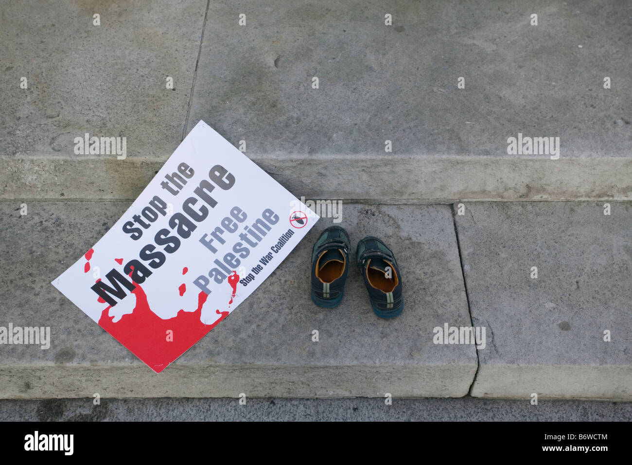Children's shoes on Cenotaph at anti-Israeli Demonstration in London after attacks on Gaza Strip. - Stock Image