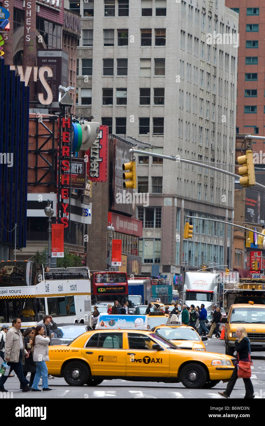 Taxicab in Times Square Manhattan New York City New York USA - Stock Image