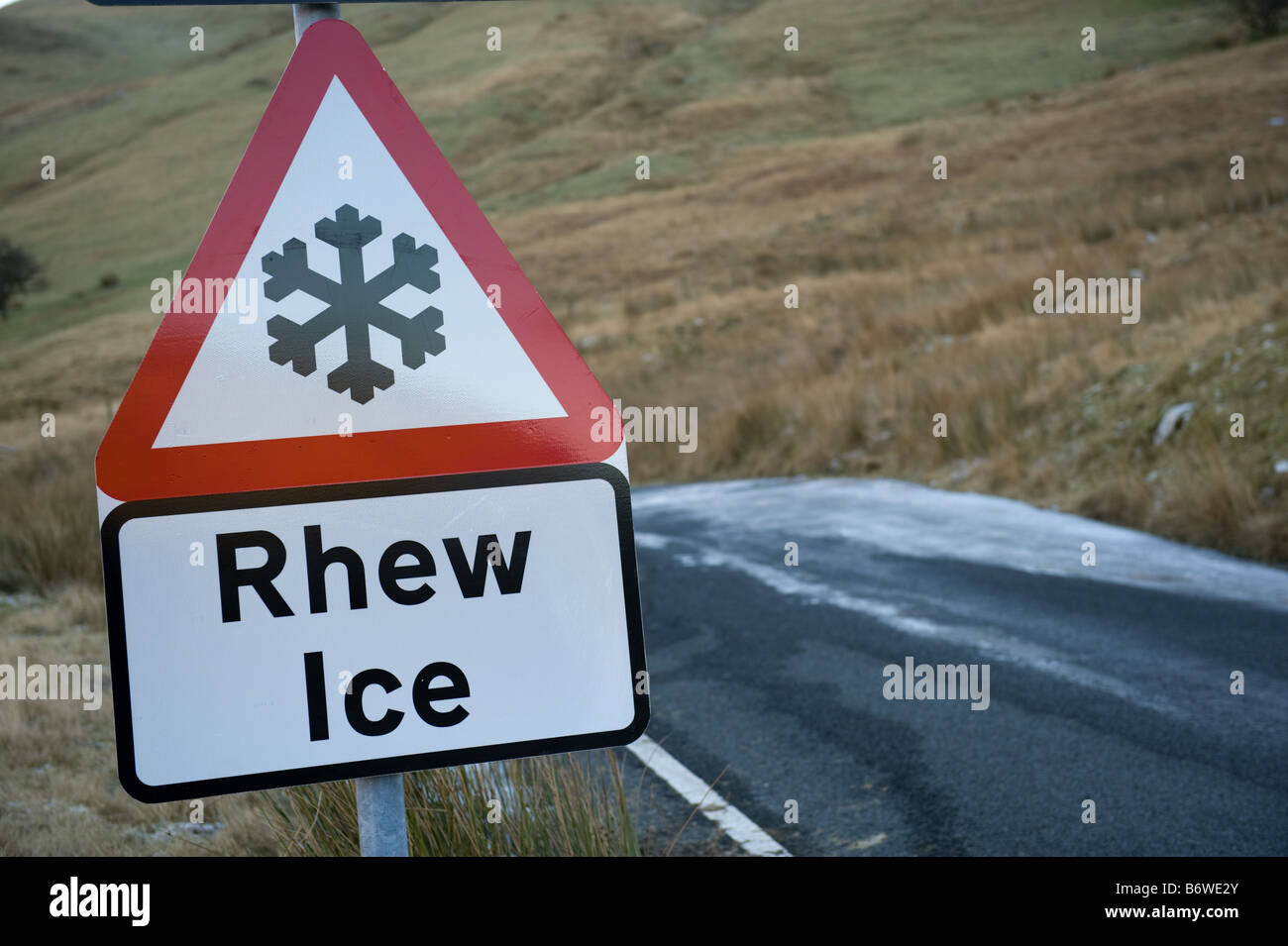 Bilingual welsh english road sign warning of Ice on the road Cwm Ystwyth mid wales - Stock Image