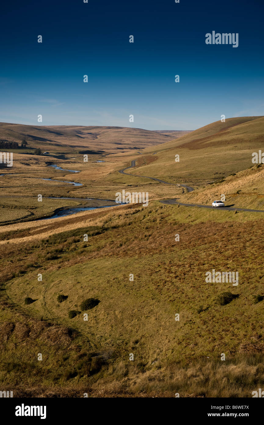 Car driving along narrow upland road in the upper Elan Valley Powys mid wales - Stock Image