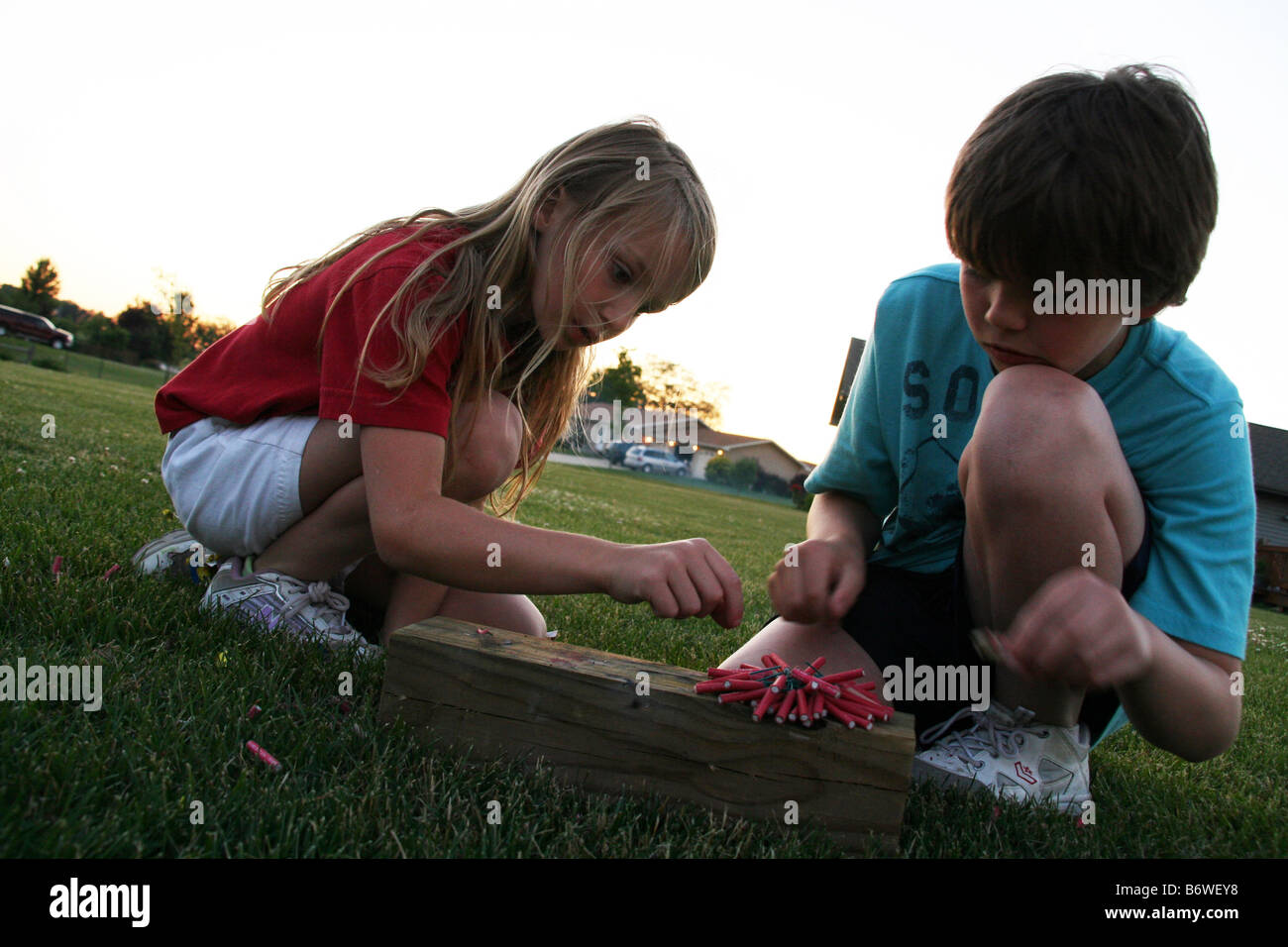 Young Children Playing With Firecrackers Stock Photo
