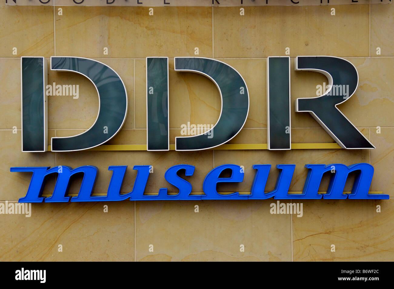 DDR sign museum berlin deutschland east germany communism soviet modern travel tourism blue wall - Stock Image