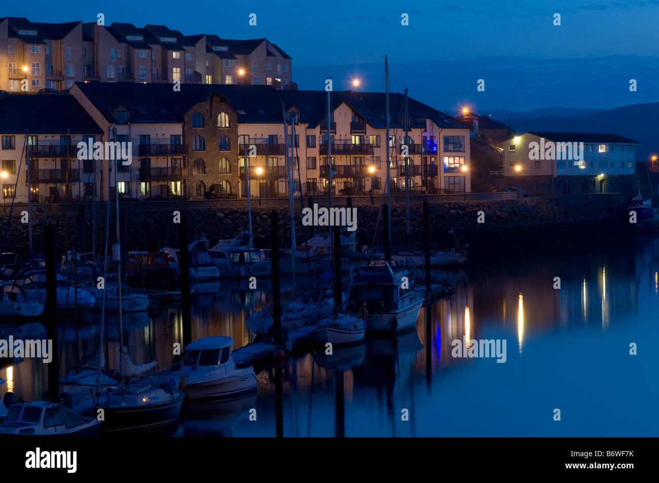 Waterside flats and apartments at dusk Aberystwyth Marina west wales UK - Stock Image