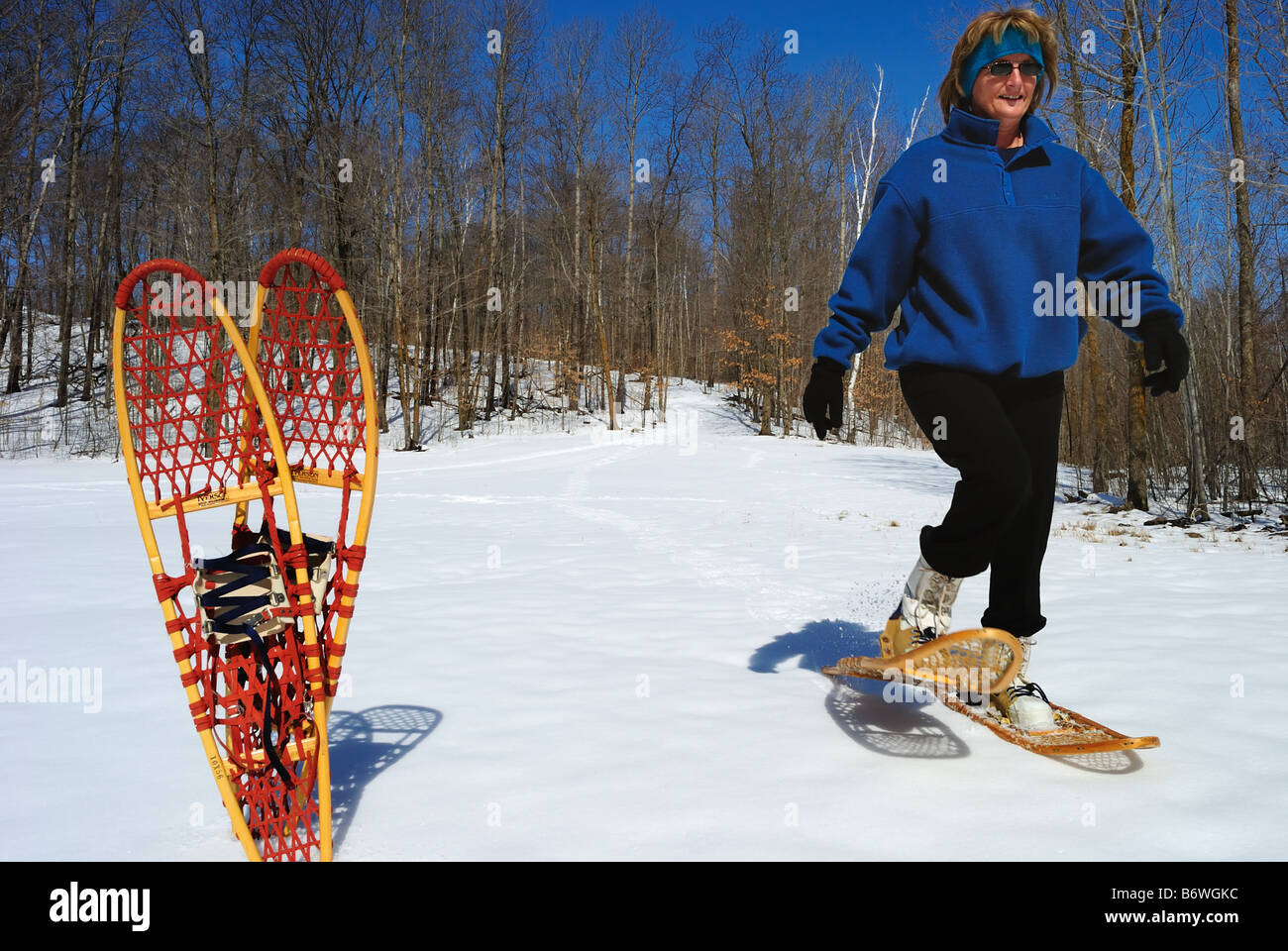 Woman snowshoing in winter Stock Photo