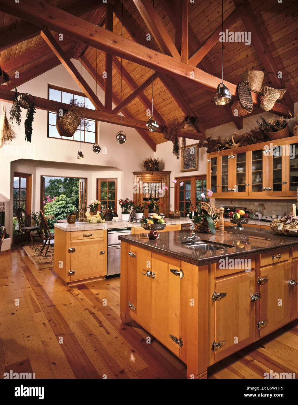 Country kitchen wood beamed ceiling cabinets spacious center stock country kitchen wood beamed ceiling cabinets spacious center island granite working area lighting house home interior aloadofball Images
