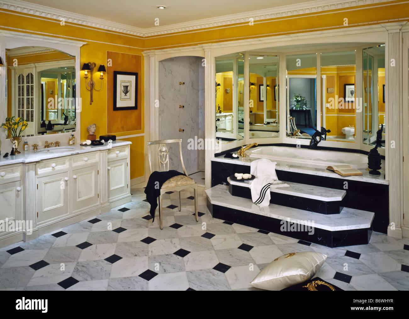 Master suite bathroom vanity lighting light bath room interior lights shower toilet washbasin house home white cabinet tub louve