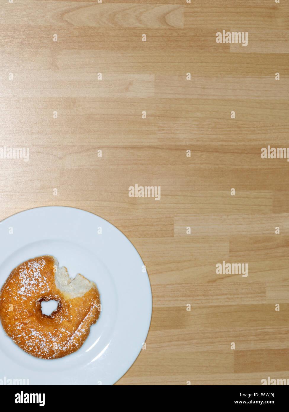 Partially Eaten Donut - Stock Image