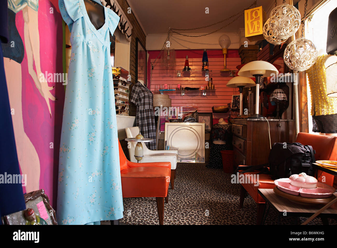 Clothing And Furniture In Crowded Second Hand Store   Stock Image