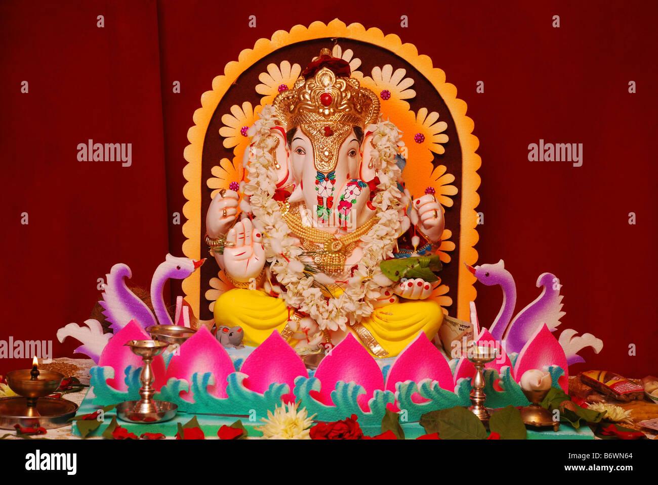 Plaster of Paris 3 dimensional statue of Hindu Deity Lord Ganesh. Maharashtra, India. - Stock Image