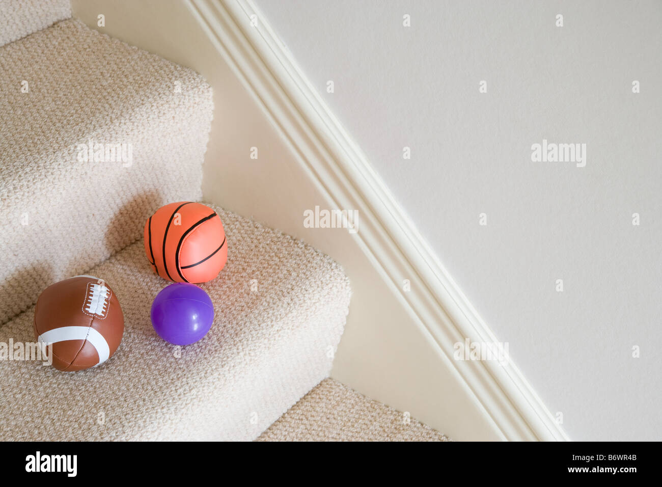 Balls on staircase - Stock Image
