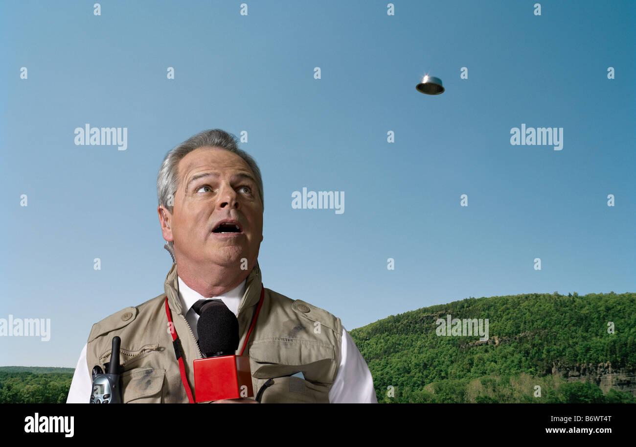News presenter and ufo - Stock Image