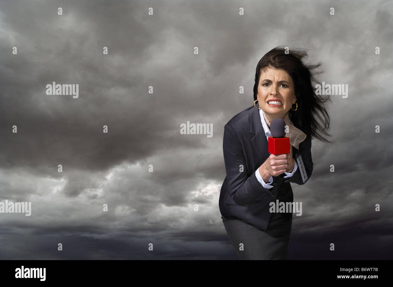 News presenter in storm - Stock Image