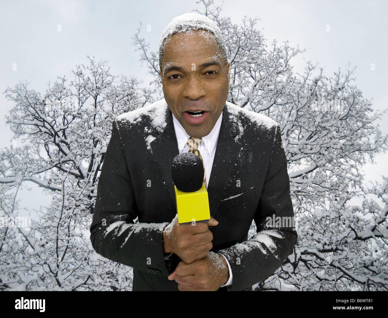 News presenter in snow - Stock Image