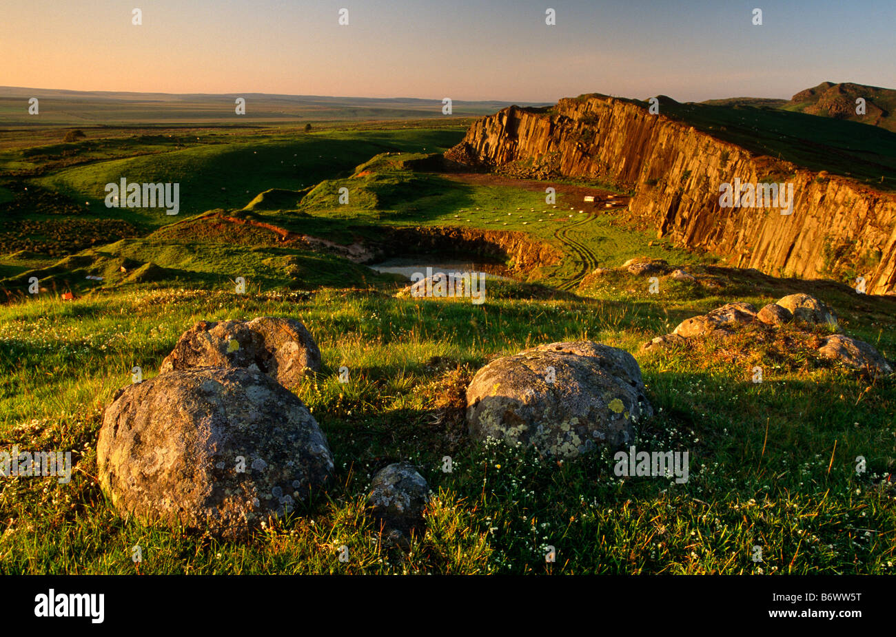 Hadrian's Wall at sunset at Walltown Crags near Greenhead, Hadrian's Wall National Trail, Northumberland - Stock Image