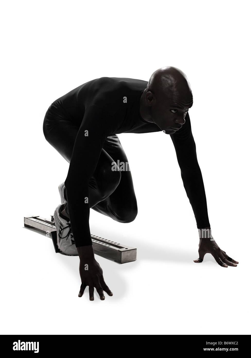 Athlete on starting blocks - Stock Image