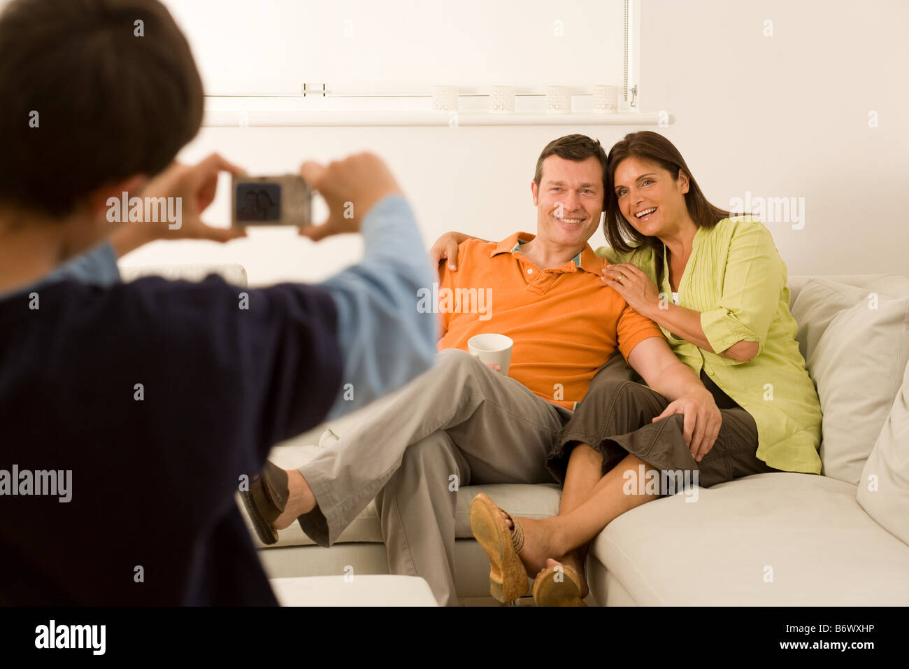 Boy taking picture of parents - Stock Image