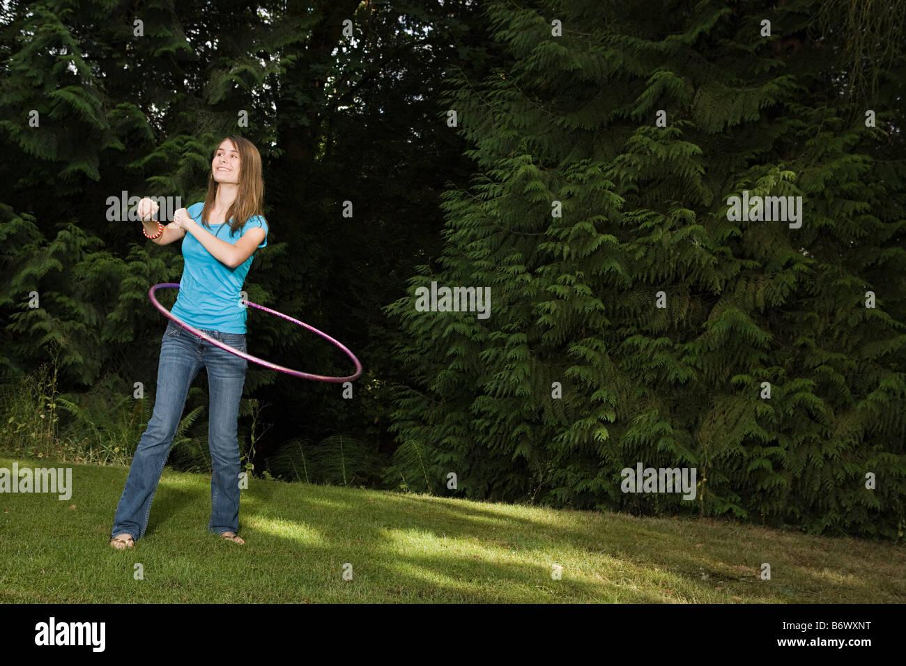 Teenage girl with plastic hoop - Stock Image