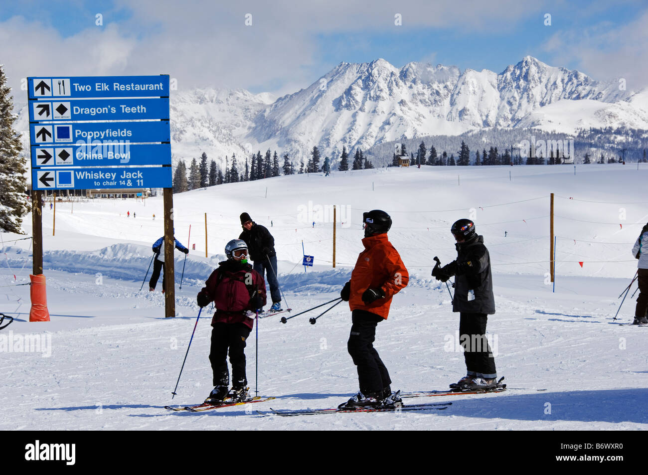 USA, Colorado, Vail Ski Resort. Skiers looking for directions infront of the Gore Mountains - Stock Image