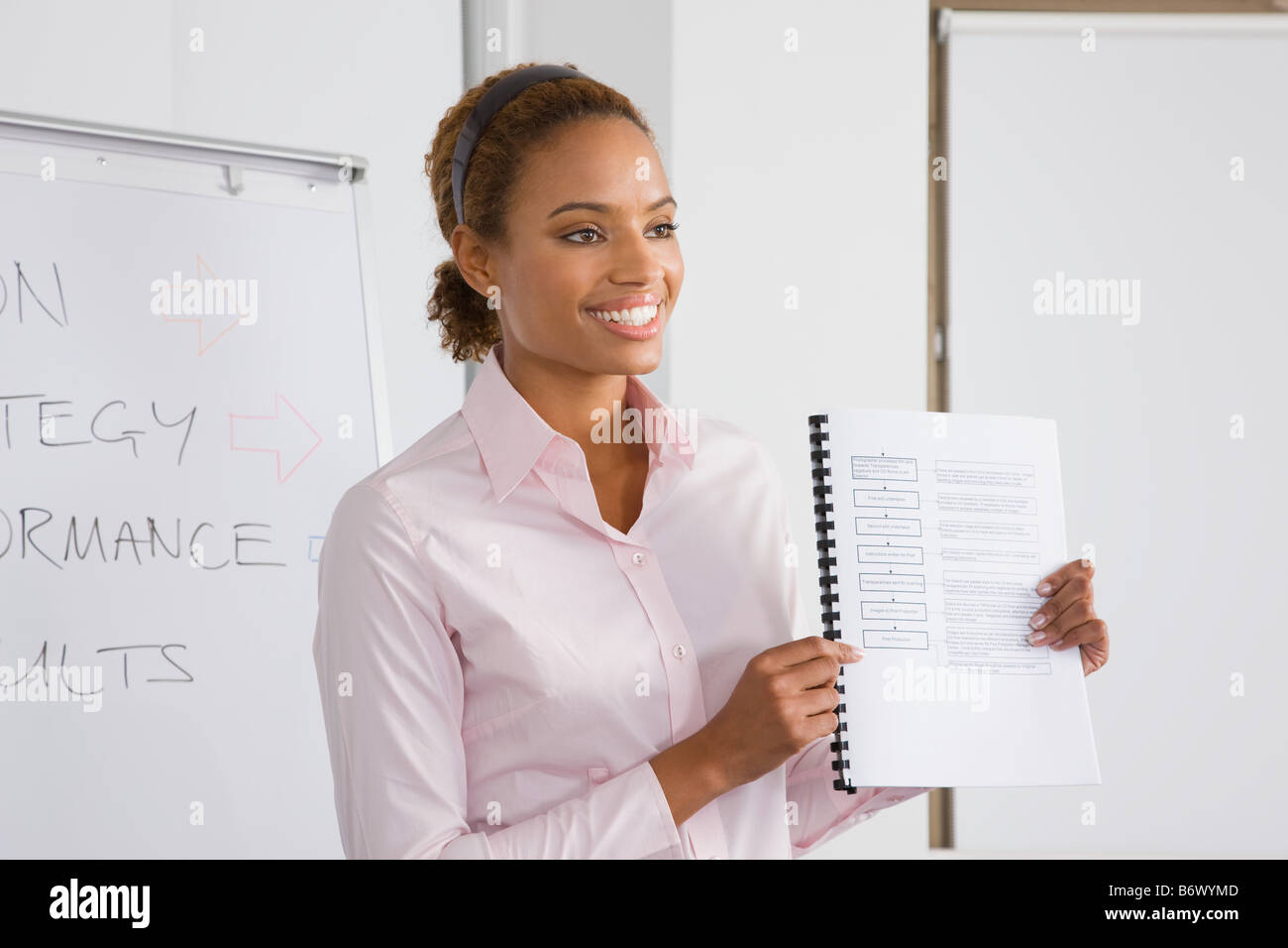 A lecturer holding a textbook - Stock Image