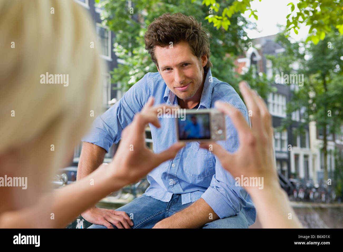 Man being photographed - Stock Image