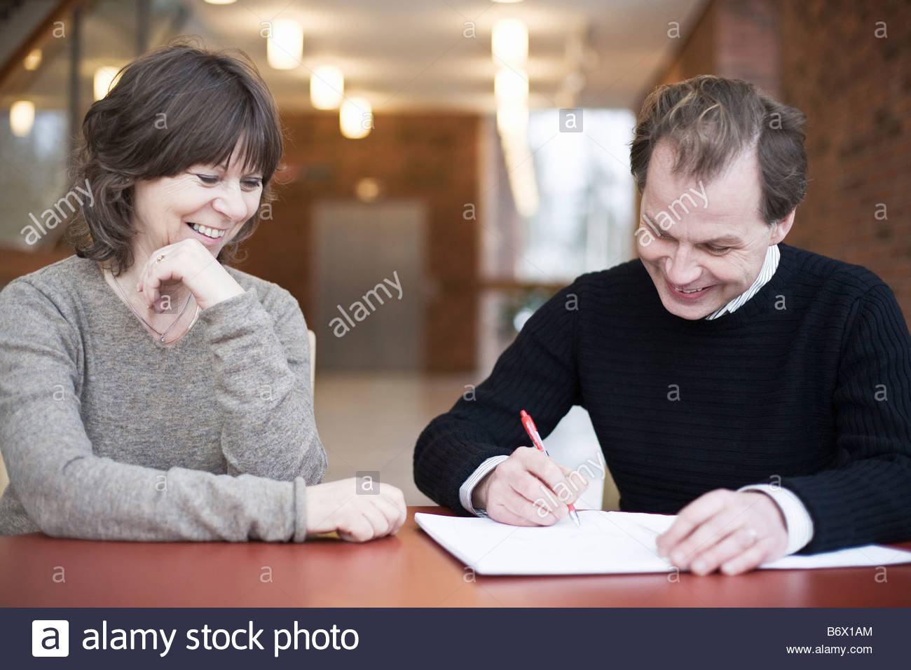 Woman and man talking - Stock Image