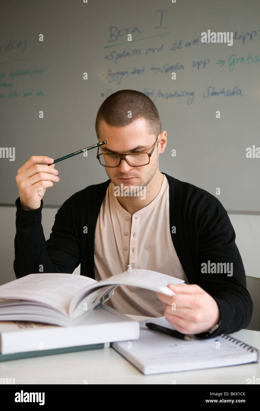 Guy concentrating on his studies - Stock Image