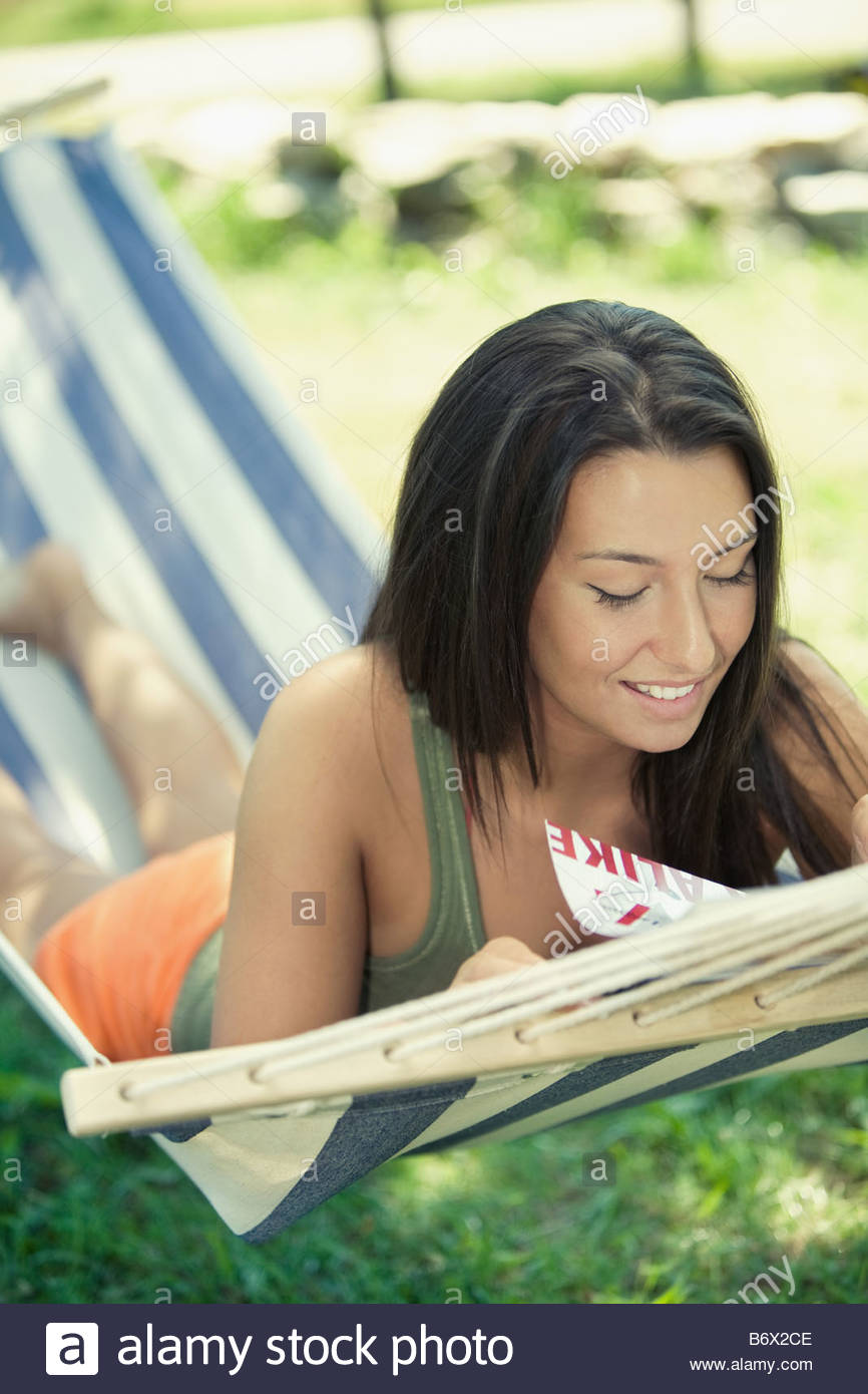 Woman hammock reading - Stock Image
