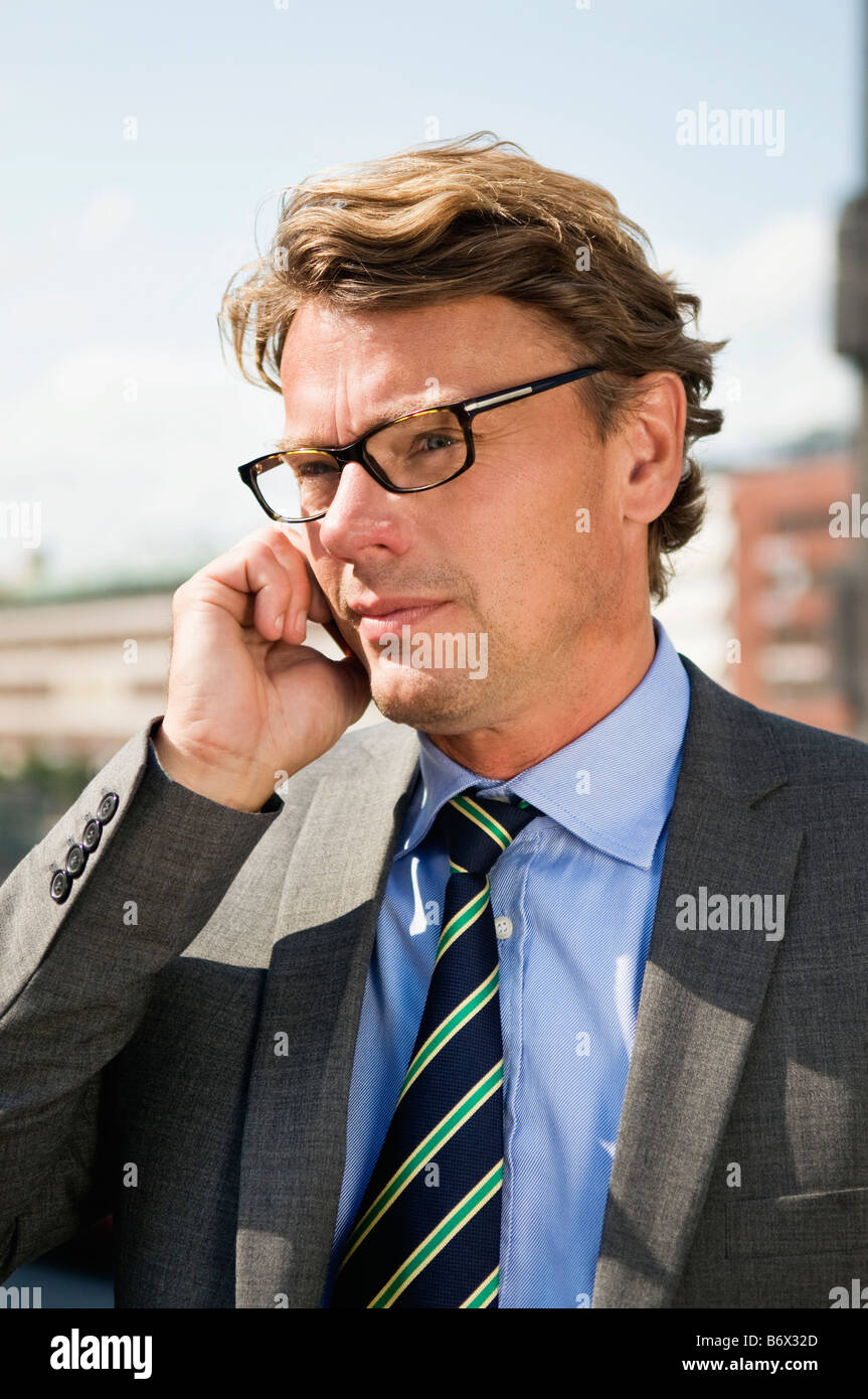 Portrait of businessman with cellphone Stock Photo