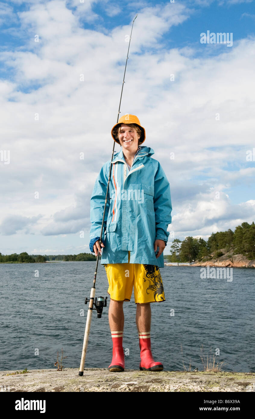 Guy in rain cloths - Stock Image