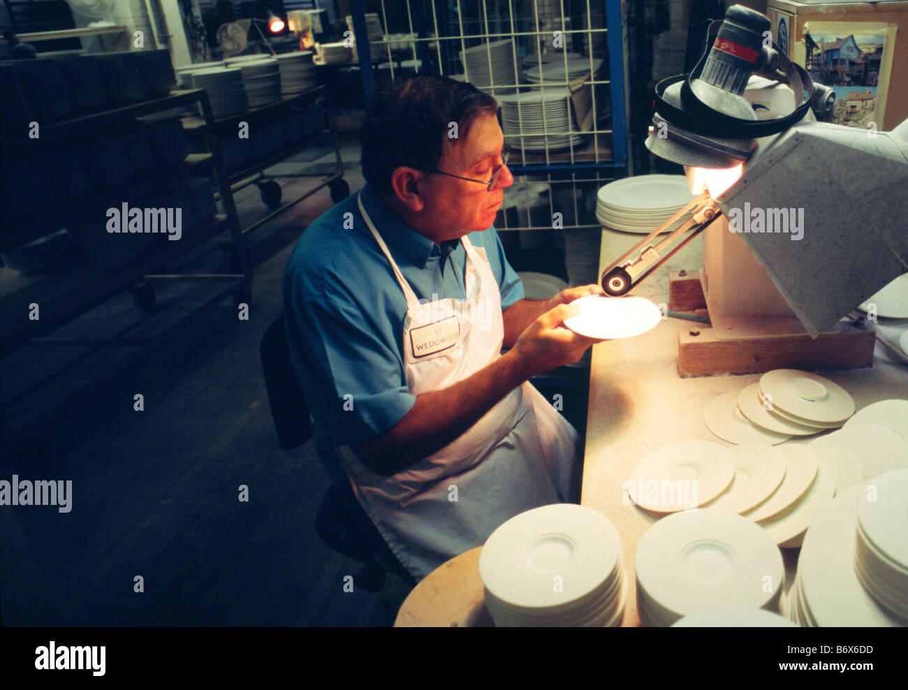 Worker inside the Waterford Wedgwood pottery Stoke on Trent Staffordshire England. The company including Wedgwood Stock Photo