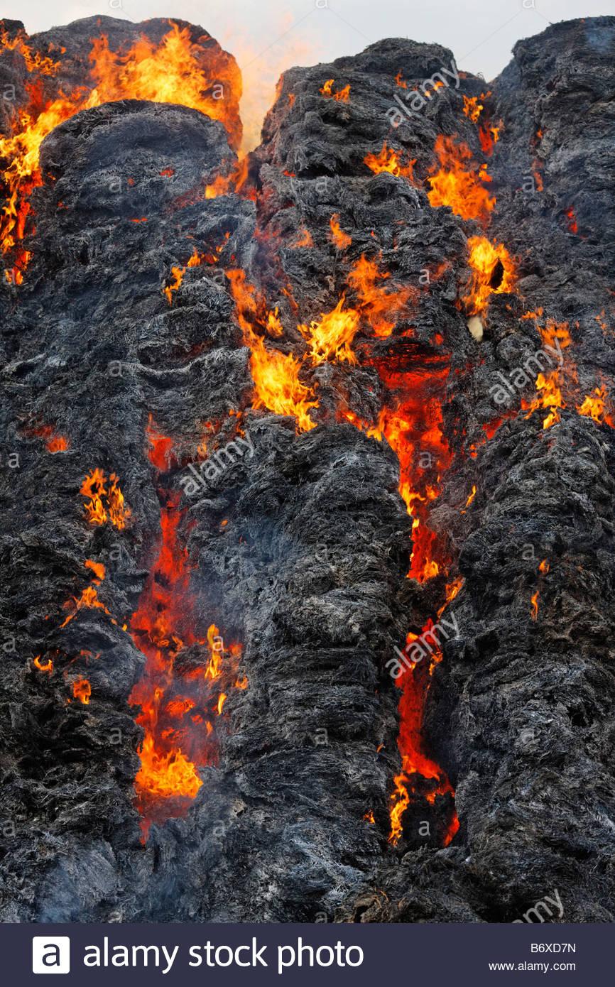 burning hay bales - Stock Image