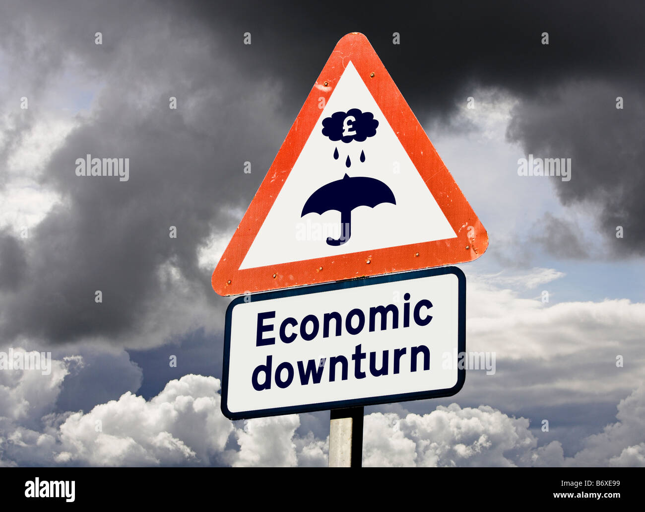 Economic downturn, recession concept UK against a stormy sky - Stock Image