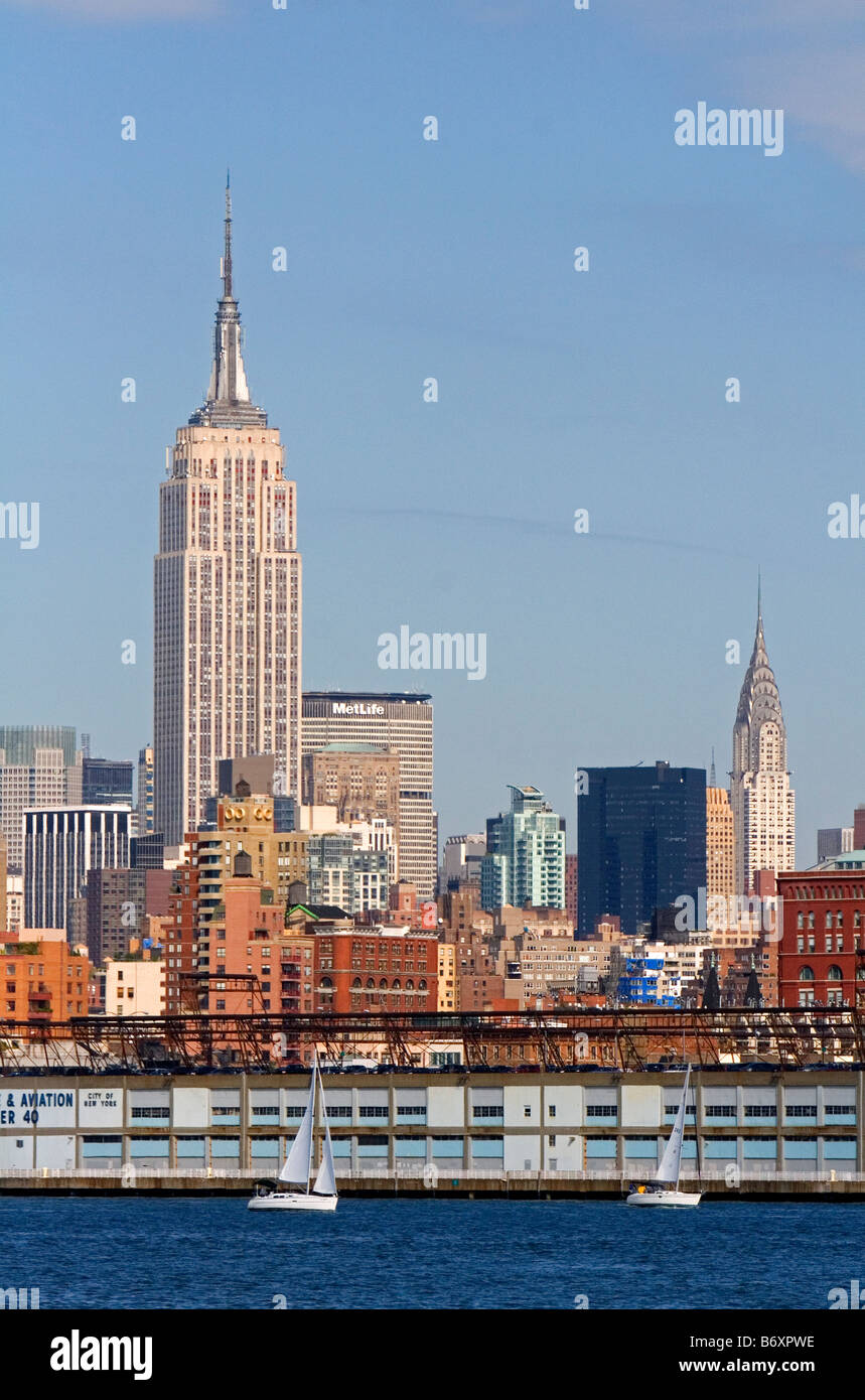 Empire State Building at left and Chrysler Building at right in New York City New York USA - Stock Image