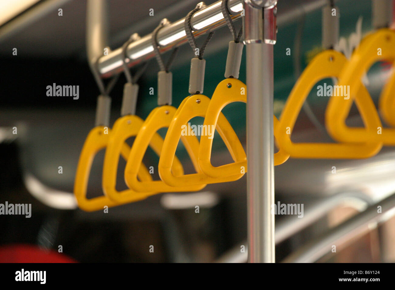 Grab handles in a bendy bus - Stock Image