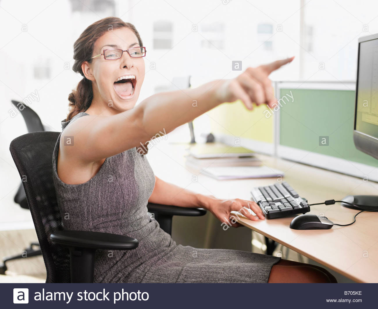 Businesswoman pointing and shouting - Stock Image