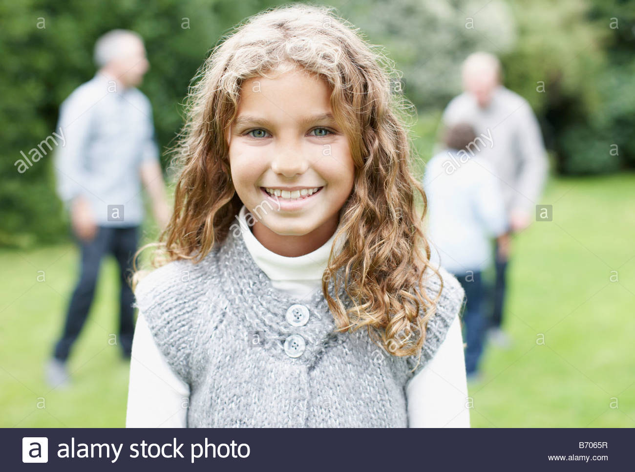 Girl in backyard with family - Stock Image