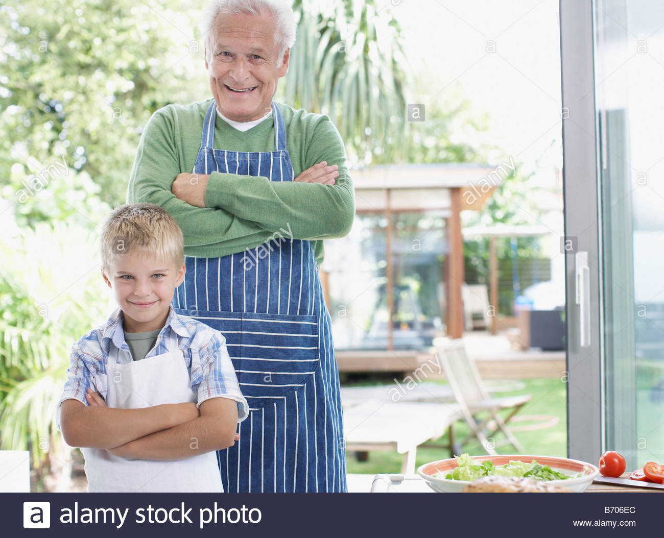 Grandfather and grandson preparing healthy meal - Stock Image