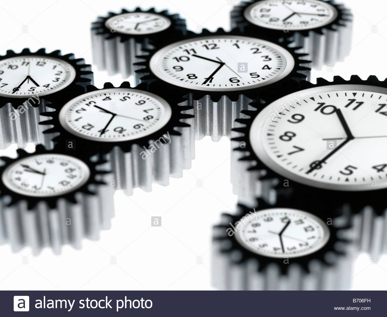 Clocks shaped like cogs - Stock Image