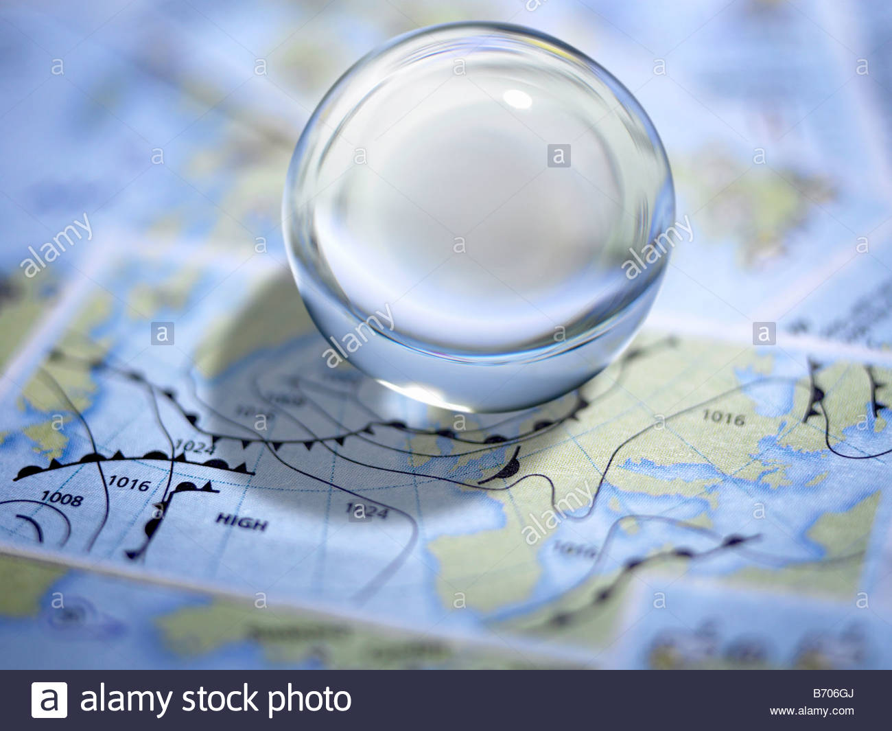 Close up of glass ball on map - Stock Image