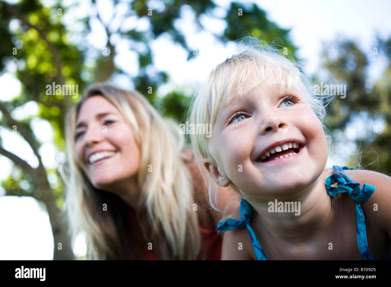 Portrait of a mom and a four year old girl in a park. Stock Photo