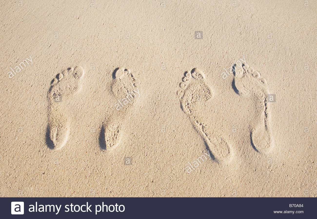 A couple's foot prints on a sandy beach in St. John. - Stock Image