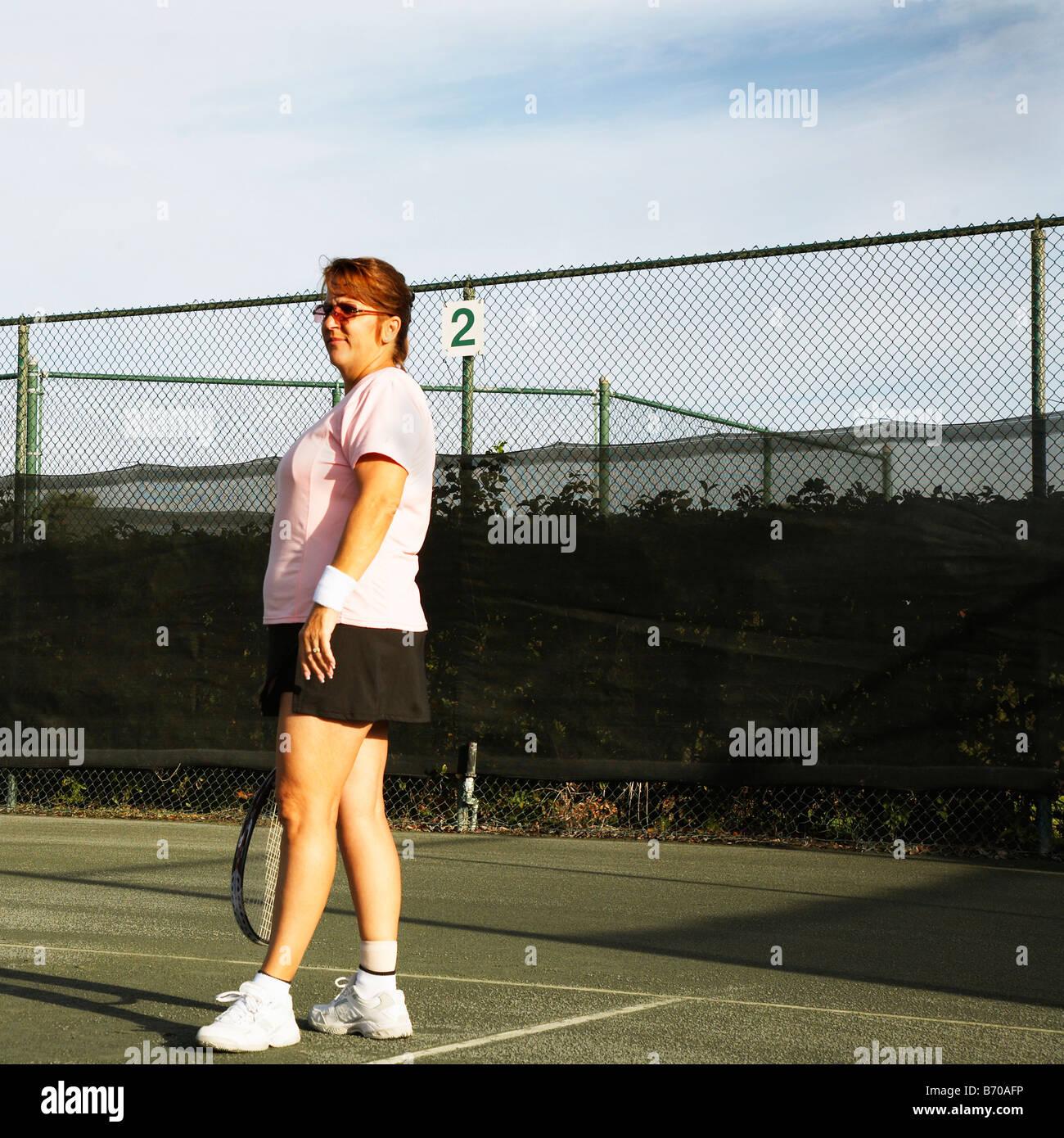 Woman playing tennis in Ft. Pierce, Florida. - Stock Image