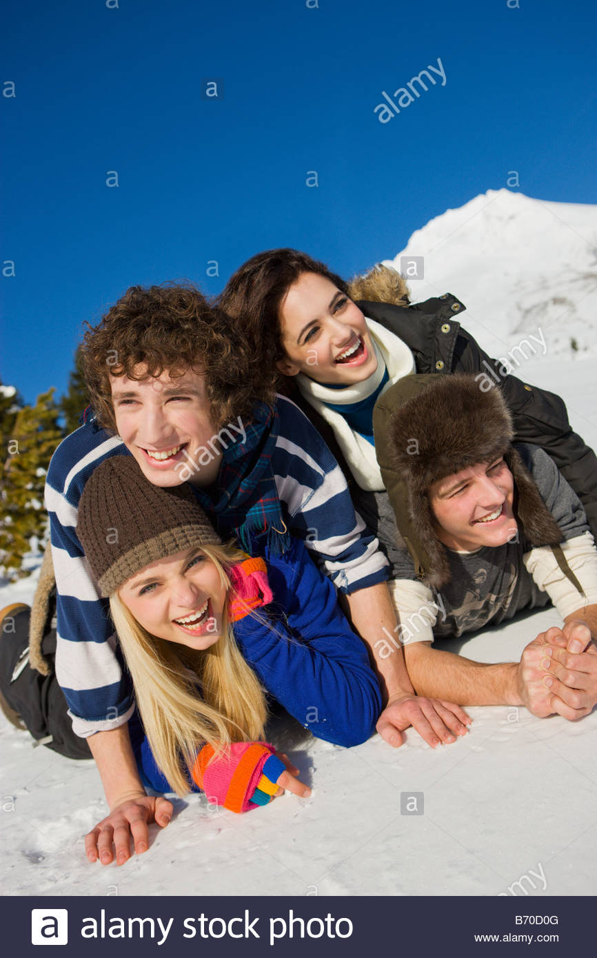 A group of adolescents playing in the snow on Mt. Hood, Oregon. - Stock Image