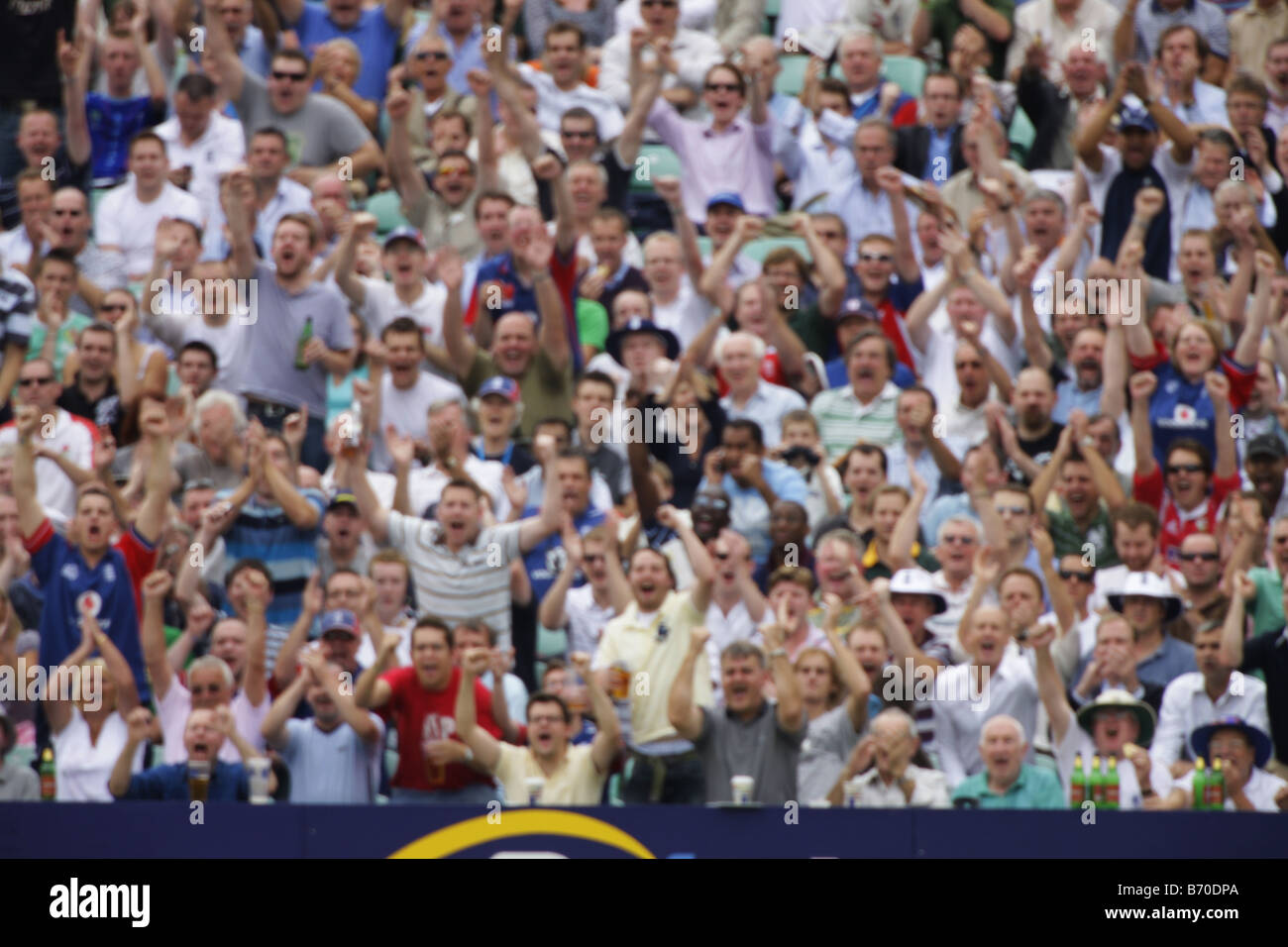 sport crowd spectators cricket fans supporters - Stock Image