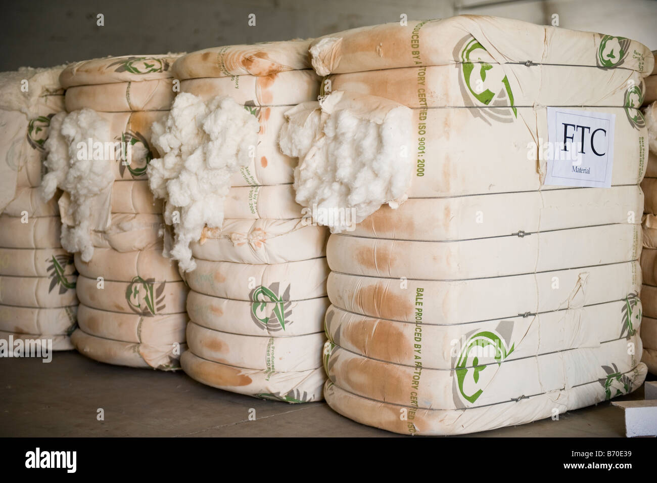 India Indore , spinning mill produce yarn from fair trade cotton, bales with FTC fair trade cotton label - Stock Image