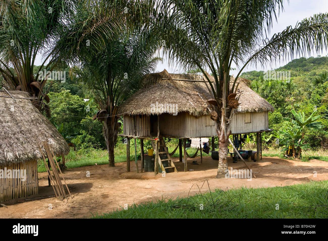 Suriname, Kwamalasamutu, home of indigenous Indians. Aerial. Huts on stilts. - Stock Image