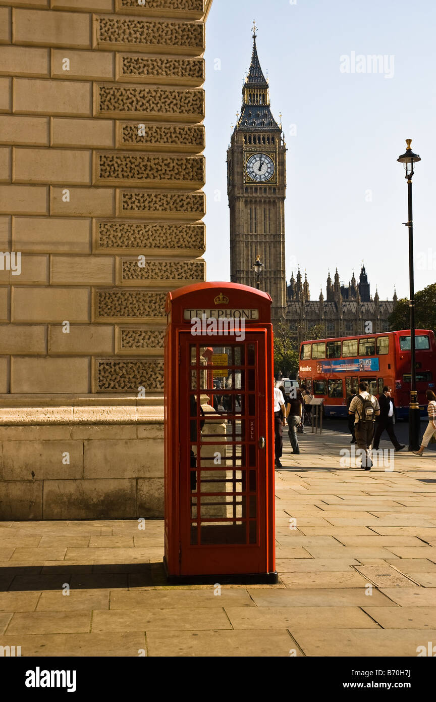 British Telephone booth with Big Ben and Red Double Decker in the background in London - Stock Image