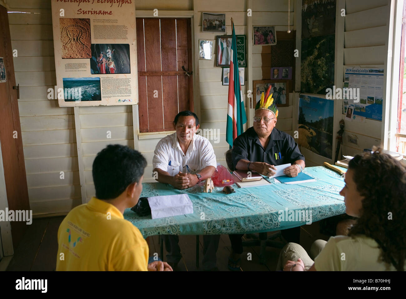 Suriname, Kwamalasamutu, home of indigenous Indians. Tourists being received by chief of village and Trio Indians. - Stock Image